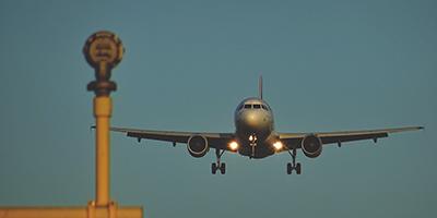 negative-space-airplane-landing-airport-sebastian-grochowicz-400